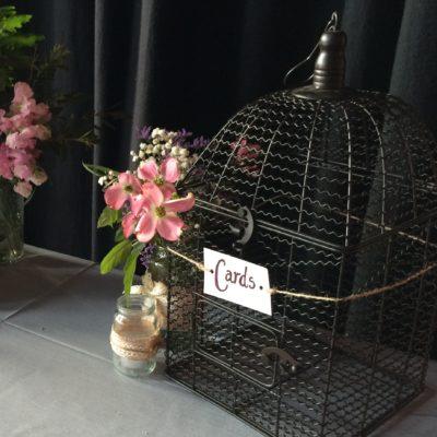 Rustic birdcage wishing well